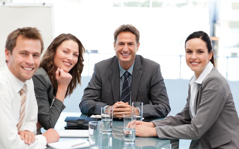 Quelle: Portrait of a positive team sitting at a table © WavebreakMediaMicro - Fotolia.com